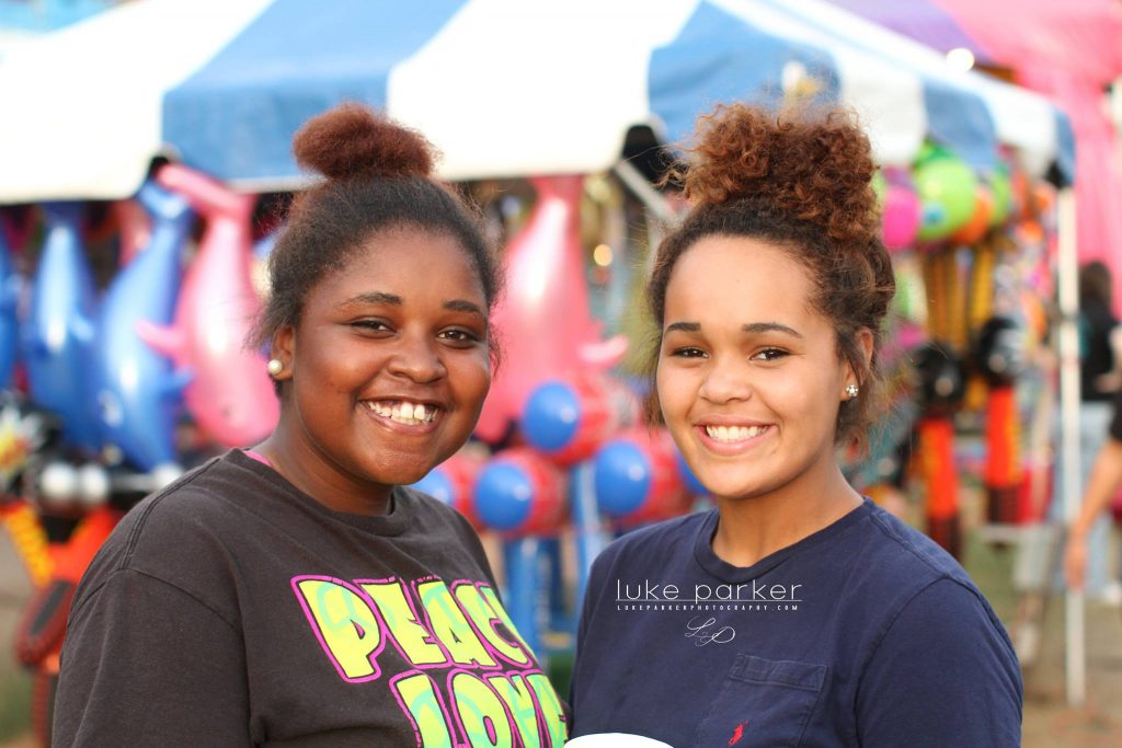two girl volunteers at the fair